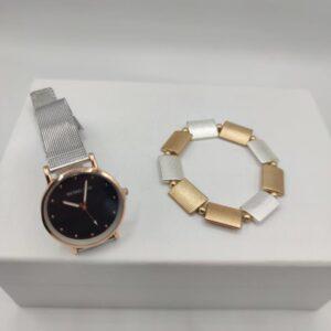 Conjunto plateado y dorado de reloj y pulsera de chica